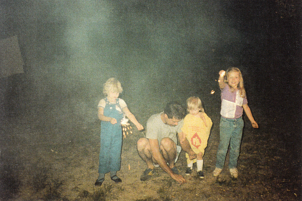 step dad and kids with sparklers