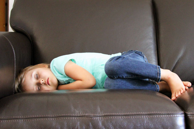 girl sleeping on couch