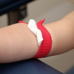 toddler getting a blood draw bandage