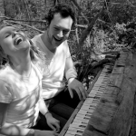 engagement photo laughing at piano