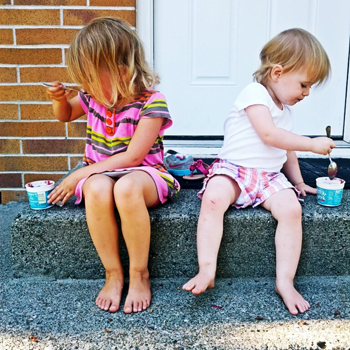 kids eating ice cream on front step