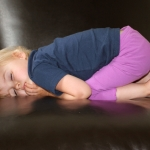 child sleeping in chair