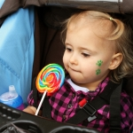 girl eating giant lollipop
