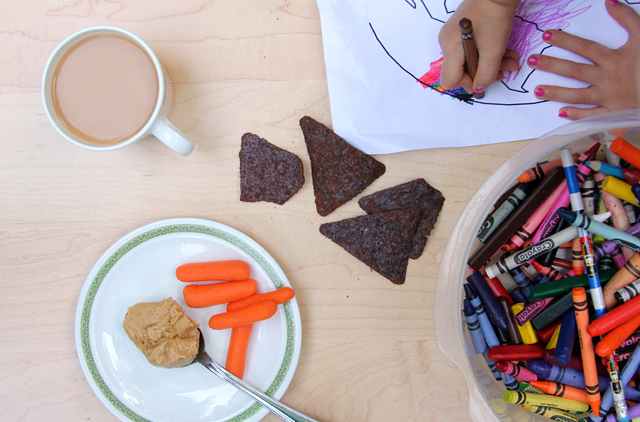 snacks carrots red hot blues coffee while kid coloring