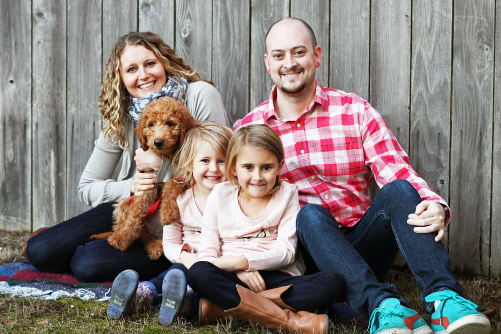 family with labradoodle dog