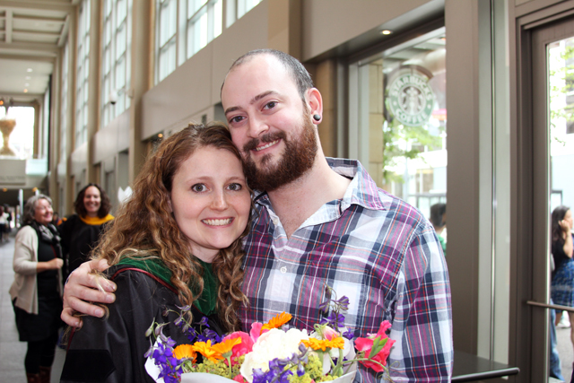 My husband and me after graduation